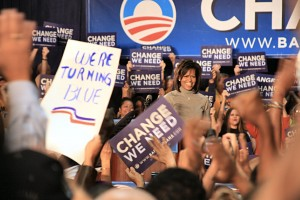 Michelle Obama, surrounded by signs.